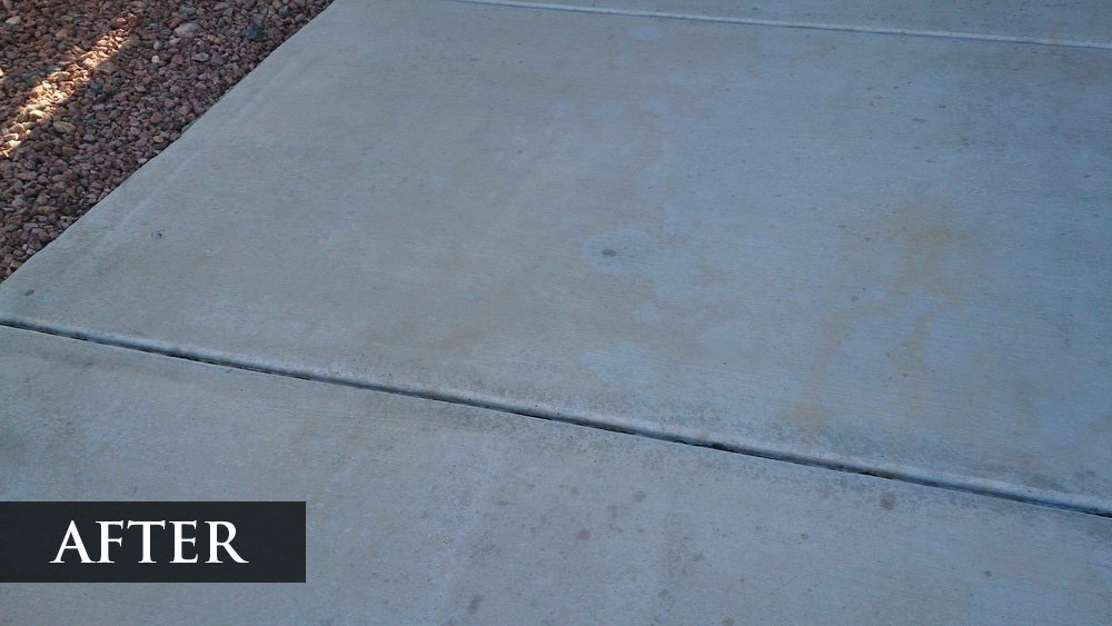 A clean driveway near rocks with the word After in the lower left corner