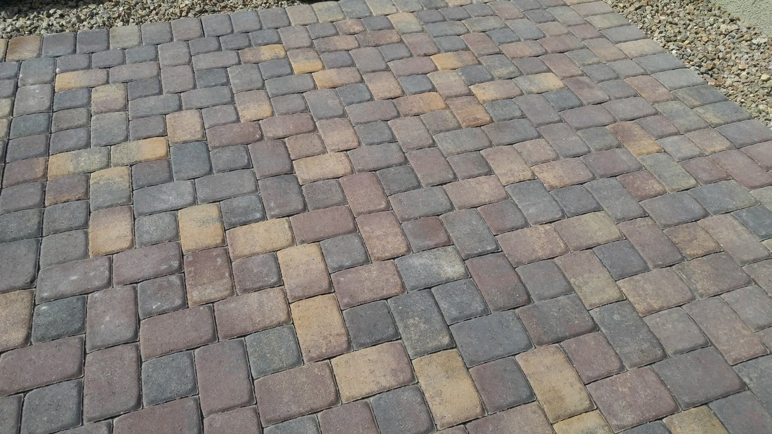 An outdoor area with paver wet sealing