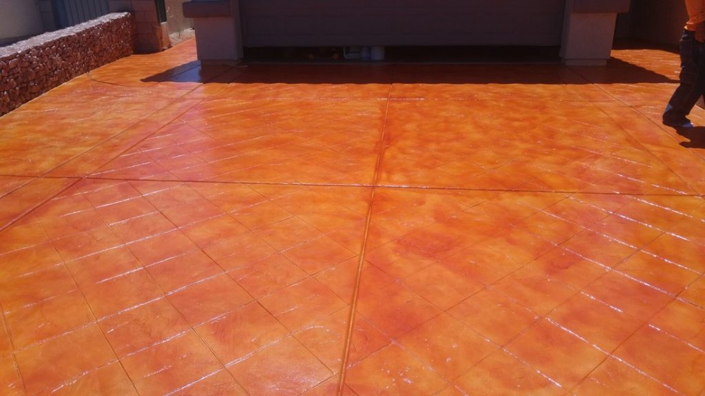 Orange concrete sealing throughout the driveway